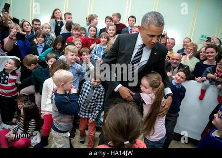 U.S. President Barack Obama greets children during the U.S. Embassy meet and greet at Hotel Adlon November 16, 2016 - Stock Photo