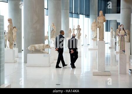 U.S. President Barack Obama tours sculpture exhibits with Acropolis Museum President Dimitrios Pandermalis November - Stock Photo