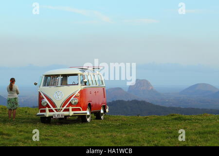 A VW Combi bus at dusk on front of the Glasshouse Mountains at Maleny, in the Sunshine Coast Hinterland, Queensland, - Stock Photo