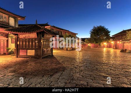 Lijiang Old Town in Yunnan, China at sunrise - by night - Stock Photo