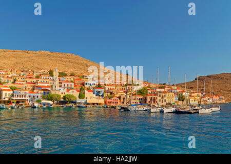 Chalki town and yacht berths, Greek island of Chalki situated off the north coast of Rhodes, Dodecanese Island group, - Stock Photo