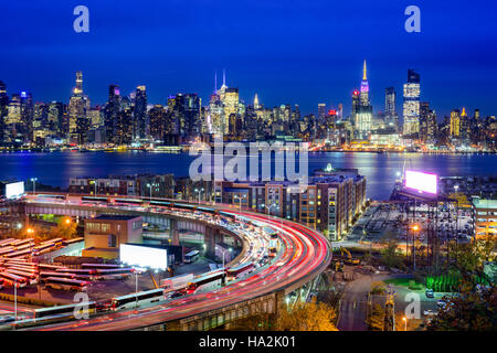 New York City skyline over The Helix Loop. - Stock Photo