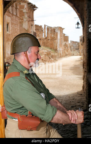 Soldier in National army uniform on guard in the ruins of Belchite, Spain - Stock Photo