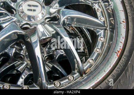 Damaged Chrome Wheel and Tire - Stock Photo