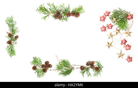 Christmas background. Floral flat lay frame. Evergreen tree branches with cones and baubles - Stock Photo