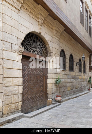 View from Darb Asfour Lane showing part of the facade of Bayt Al-Suhaymi, an old Ottoman era house in Medieval Cairo, - Stock Photo