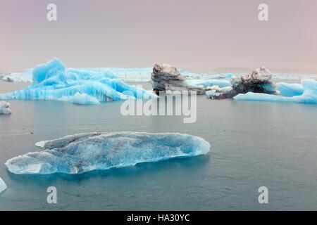 Icebergs in Jokulsarlon, a glacial lake in southeast Iceland, on the edge of Vatnajokull National Park - Stock Photo