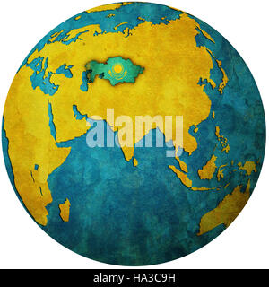 isolated over white territory of kazakhstan with flag on globe map - Stock Photo