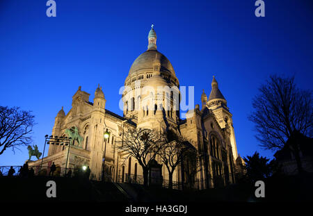 Basilica of Sacre Coeur at night in Paris, France - Stock Photo