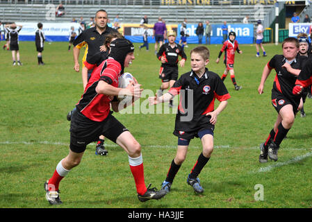teenage boys playing rugby - Stock Photo