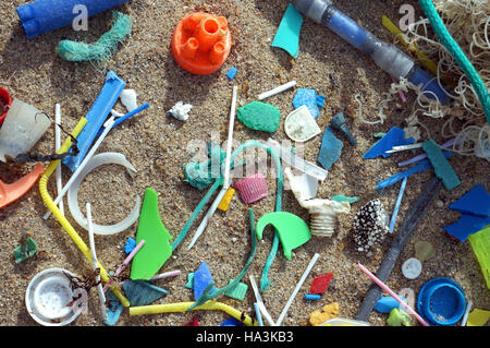 Plastic debris washed ashore on the beach. Plastic pollution. Portugal - Stock Photo