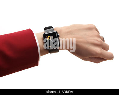 Woman hand with Apple Watch series 2 smartwatch on her wrist isolated on white background - Stock Photo