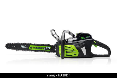 Electric Cordless battery powered chainsaw Greenworks isolated on white background - Stock Photo