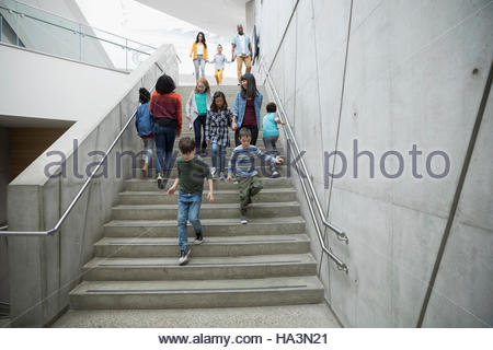 Children and parents walking on stairs - Stock Photo
