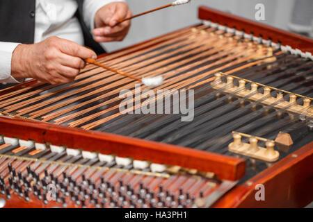 Playing the dulcimer folk musical instrument - Stock Photo