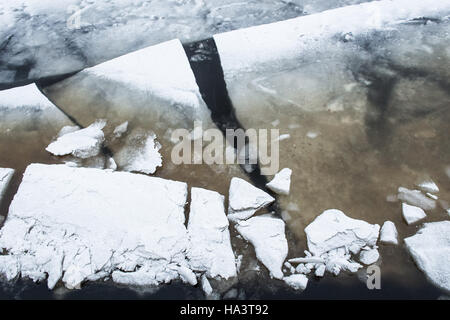 Ice floes covered fresh snow on the river, close up texture - Stock Photo