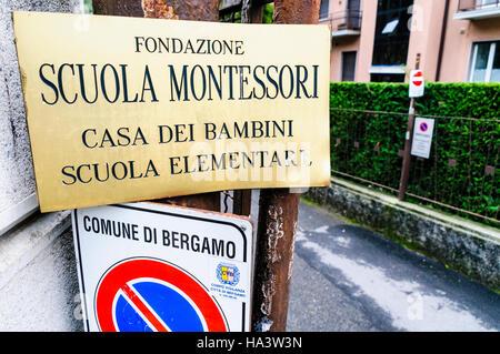 Sign for the Scuola Montessori school in Bergamo. - Stock Photo