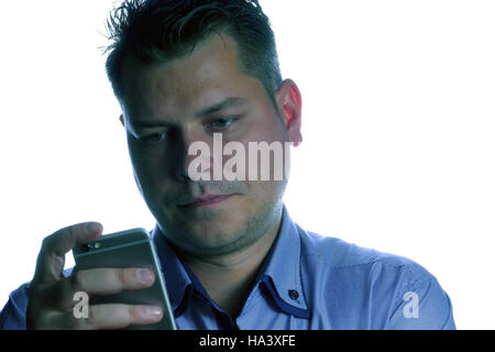 Man looking upset on the phone isolated on a white background - Stock Photo