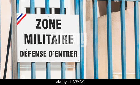 french sign 'Military Zone, no entry' on a gate - Stock Photo