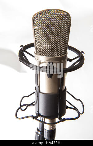 A studio condenser microphone in a floating cage stand - Stock Photo
