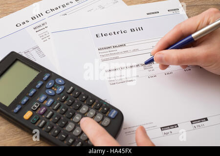 Electric bill charges paper form on the table - Stock Photo