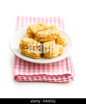 Sweet almond cookies on plate isolated on white background. - Stock Photo