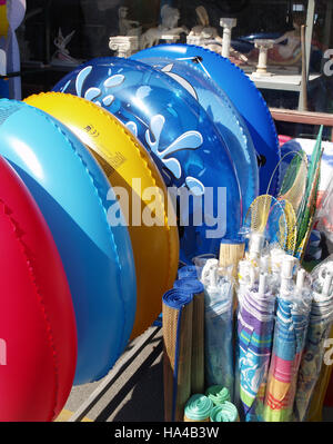 Inflatable rings and other souvenirs For Sale in Roda, Corfu, Greece - Stock Photo