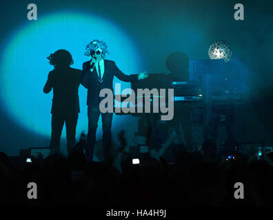 Pop group the Pet Shop Boys, Neil Tennant (L) and Chris Lowe (r) playing on stage in the arena in Leipzig, Germany, - Stock Photo