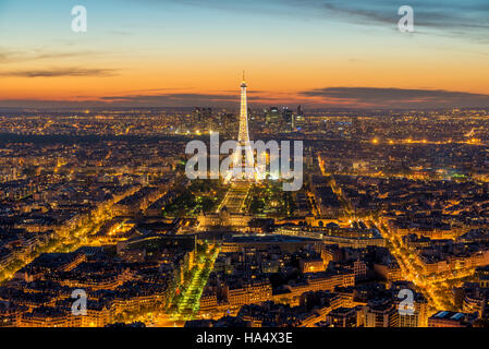 Beautiful view Eiffel tower during light show at dusk, Paris, France. - Stock Photo