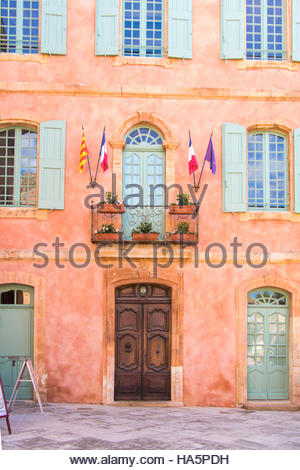 Medieval Village of Roussillon, departement of Vaucluse, Provence, France, mairie, city hall with french flag on - Stock Photo