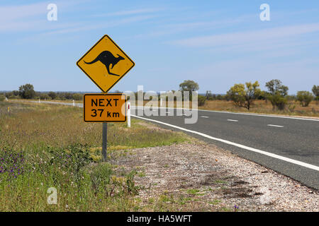 Kangaroo warning sign on the roadside in the outback - Stock Photo