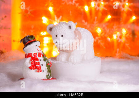Snowman with polar bear, Happy New Year 2017, Christmas, bright defocused lights in background - Stock Photo