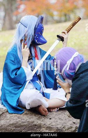 Young japanese girl dressed in cosplay costume at Mamugame-Jou Park - Stock Photo