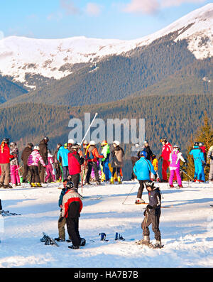 Lots of people at top of a slope in Bukovel. Bukovel is the most popular ski resort in Ukraine, in 2012 was named - Stock Photo