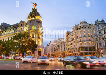 Traffic on Downtown of Madrid at twilight. Spain - Stock Photo