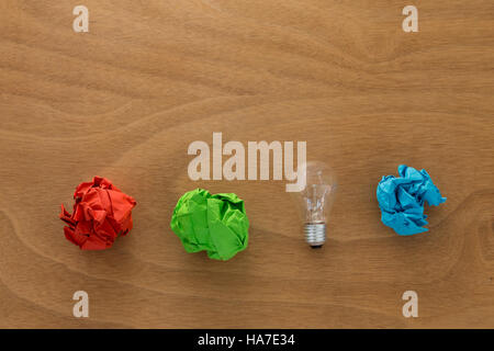 Great idea concept with crumpled colorful paper and light bulb - Stock Photo