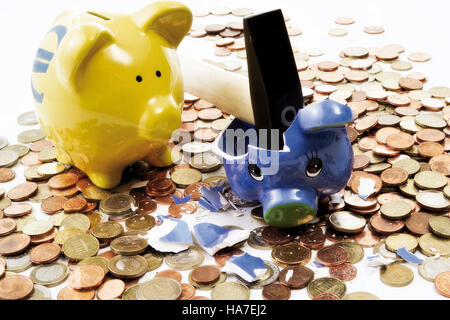 Piggy bank smashed by a hammer - Stock Photo