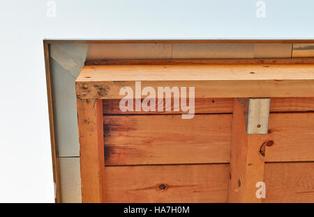 Roof under construction with wood frame and Zinc from behind - Stock Photo