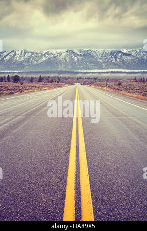 Vintage toned scenic road in the Grand Teton National Park, Wyoming, USA. - Stock Photo