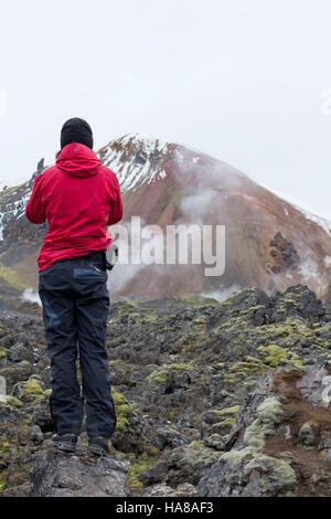 Hiker looking at Brennisteinsalda - Stock Photo