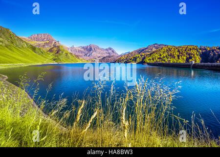 View of lake Ritom in Piora, Canton Ticino of Switzerland with Swiss Alps in the background, Switzerland, Europe. - Stock Photo