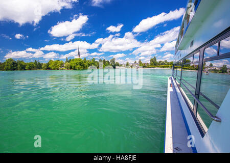 Beautiful Swiss landscape view from famous boat at Lake Zug on a sunny day with blue sky and clouds in summer, Canton - Stock Photo
