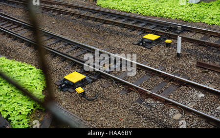railway after rain with rock and stone in depok indonesia - Stock Photo