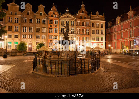 City of Gdansk by night in Poland, Old Town, Long Market street with Neptune Fountain, historic tenement houses - Stock Photo