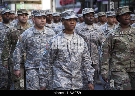 Veterans Day Parade; also known as America's Parade; marches up 5th Avenue in New York City. US Army reservists, - Stock Photo