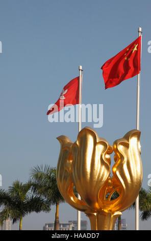 China, Hong Kong, Wan Chai, Golden Bauhinia Square, Hong Kong and Chinese flags, - Stock Photo