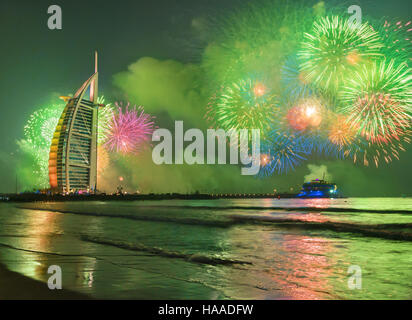Burj Al Arab in Dubai Jumeirah Beach celebarating the new year eve - Stock Photo