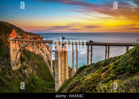 Bixby Bridge (Rocky Creek Bridge) and Pacific Coast Highway at sunset near Big Sur in California, USA. Long exposure. - Stock Photo