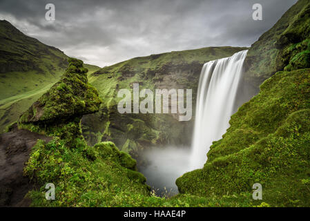 Skogafoss waterfall in southern Iceland viewed from above. Long exposure. - Stock Photo