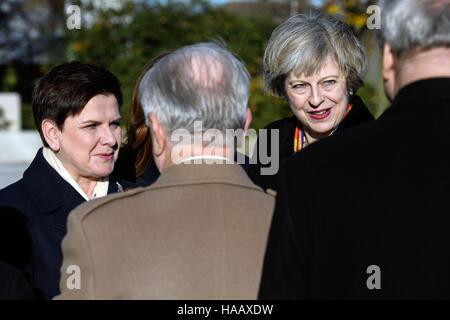 Prime Minister Theresa May (right) and Polish Prime Minister Beata Szydlo meet Polish Second World War veterans - Stock Photo
